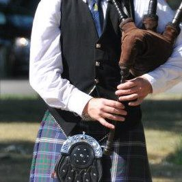 Piper playing bagpipe