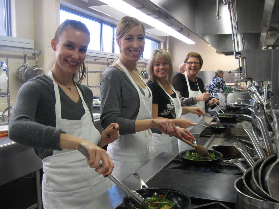 Employees participating in a Wellness Committee cooking class
