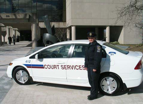 Court Services Officer in front of Court House