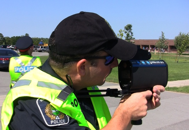 Officer performing lidar enforcement
