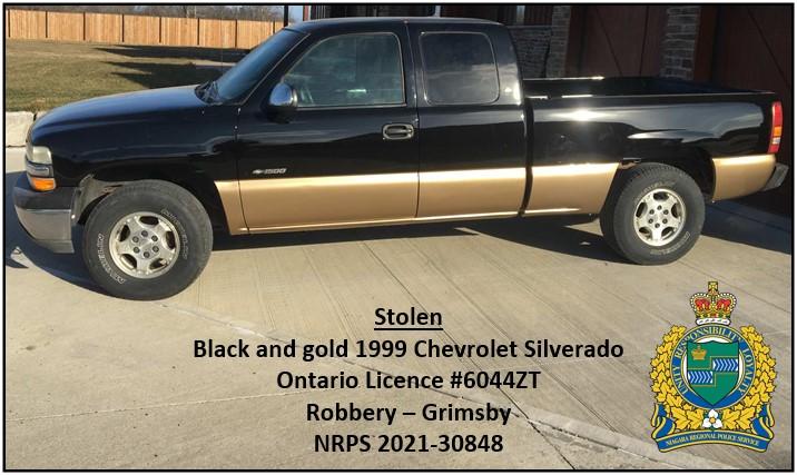 black and gold Chevrolet silverado pick up truck